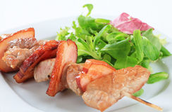 Pork skewer with salad greens Royalty Free Stock Photo