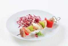 Pork skewer with shredded cabbage Stock Images