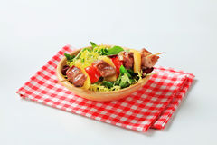 Pork skewer and spring salad mix Stock Photo