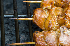 A pork skewer stick on the grill royalty free stock photo