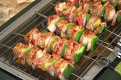 Pork skewers. On electric bbq grill Stock Photo