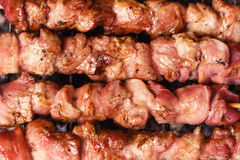 Pork skewers on a grill Stock Photo