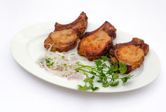 Pork skewers with onions and herbs. On white plate Stock Photos