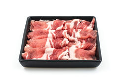 Pork slide. Together placed in a tray of black stock photography