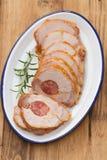 Pork with smoked sausage on white dish Stock Photo