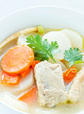 Pork soup and vegetable. In a white bowl Stock Photo