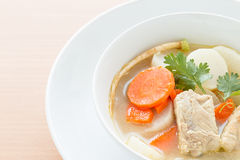 Pork soup and vegetable. In a white bowl Royalty Free Stock Photography