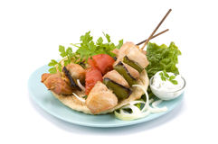 Pork souvlaki and pitta Stock Photos