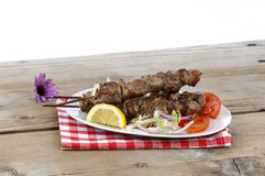 Pork souvlaki in a plate Stock Photos