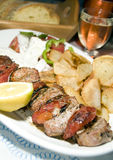 Pork souvlaki with tzatiki house wine bread Stock Photo