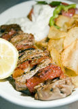 Pork souvlaki with tzatziki taverna food Greece Stock Image