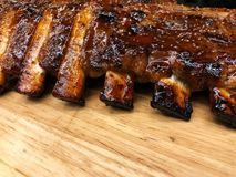 Pork Spare Ribs Barbecue on wooden plate royalty free stock photography