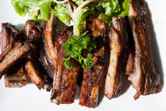 Pork spare ribs with salad and French Fries Royalty Free Stock Photography
