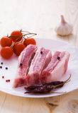 Pork sparerib raw with spices on plate Stock Images