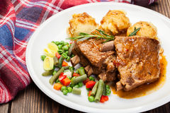 Pork spareribs served with mashed potatoes Stock Image