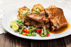 Pork spareribs served with mashed potatoes Stock Images