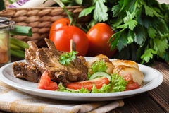 Pork spareribs served with silesian noodles and sauce Royalty Free Stock Photo