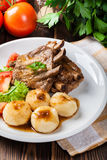 Pork spareribs served with silesian noodles and sauce Royalty Free Stock Photography