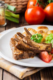 Pork spareribs served with silesian noodles and sauce Royalty Free Stock Images