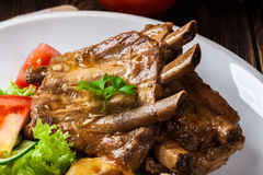 Pork spareribs served with silesian noodles and sauce Stock Photo