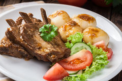 Pork spareribs served with silesian noodles and sauce Stock Images