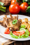 Pork spareribs served with silesian noodles and sauce Royalty Free Stock Photos