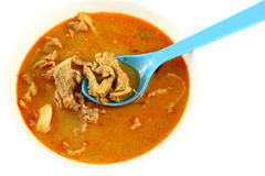 Pork spicy curry with blue spoon Royalty Free Stock Image