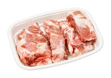 Pork spine bone for soup. In biodegradable plastic tray, deep focus stacking image, include pen tool path stock photo