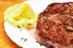 Pork steak. A closeup view of a delicious grilled pork steak royalty free stock images