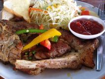 The pork steak that is arranged in the dish looks very appetizing. royalty free stock photography