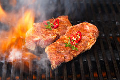 Pork steak on bbq grill with flame Royalty Free Stock Photo