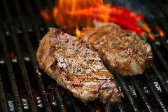 Pork steak on bbq grill with flame. Pork steak meat on bbq grill , home made stock images