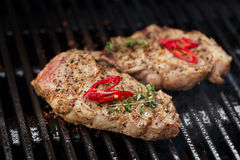 Pork steak on bbq grill no flame Stock Images