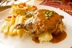 Pork steak with black pepper. And salad Stock Image