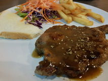 Pork Steak with black pepper. With salad Stock Image