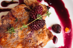 Pork steak on the bone with cherry-ginger sauce. Concept: restaurant menus, healthy eating, homemade, gourmands, gluttony. Pork steak on the bone with cherry royalty free stock images