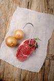 Pork steak on a butchers hook Royalty Free Stock Photo