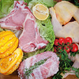 Pork steak, chicken legs with pumpkin tomato and rosemary Royalty Free Stock Photo