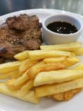 Pork steak. With chip ready for eat Stock Photo