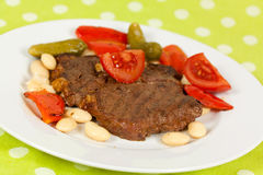 Pork steak-cutlet,roasted on the grill royalty free stock photo