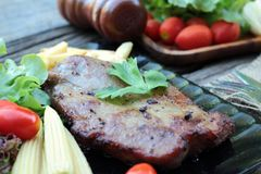 Pork steak of delicious with vegetable and tomato. Stock Image