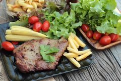 Pork steak of delicious with vegetable and tomato. Royalty Free Stock Photos