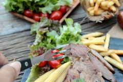 Pork steak of delicious with vegetable and tomato. Stock Photos