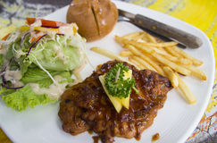 Pork steak. With french fries, bread and salad Royalty Free Stock Photo