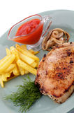 Pork Steak, French Fries and Grilled Onions Stock Photos