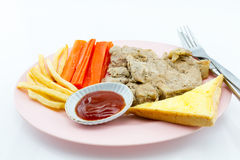 Pork steak, french fries, ketchup, bread, white background. Pork steak, french fries, ketchup, bread in the dish on a white background Royalty Free Stock Images
