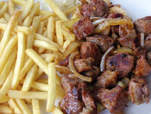 Pork steak with french fries Royalty Free Stock Images
