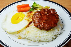 Pork steak and fried egg with Japanese rice royalty free stock images