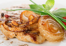 Pork steak with fried onion Royalty Free Stock Photography