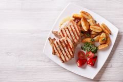 Pork steak and fried potatoes top view horizontal Royalty Free Stock Photography